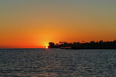 Photograph - Sunsetting Behind Coastline by Kathleen McGinley