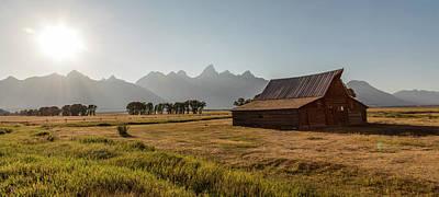 Photograph - Sunsetting Mormon Row Wyoming  by John McGraw