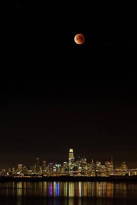 Nirvana - Super Blue Moon Lunar Eclipse over the San Francisco Skyline by Rick Pisio