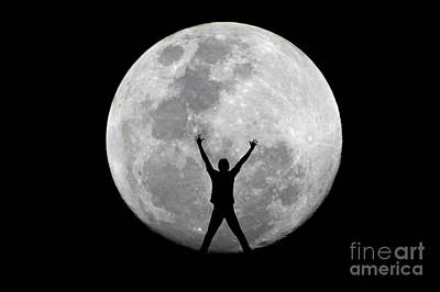 Photograph - Super Full Moon With Figure by Christopher Shellhammer