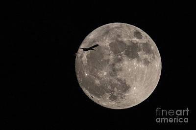Super Moon And Plane Art Print by Jennifer Ludlum