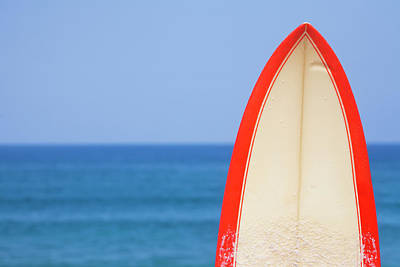 Clear Sky Photograph - Surfboard By Sea by Alex Bramwell