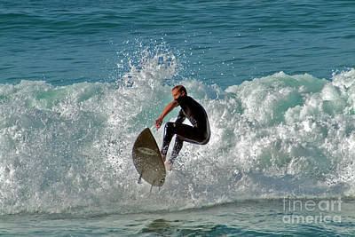 Photograph - Surfer Landing After Catching Air  by David Zanzinger