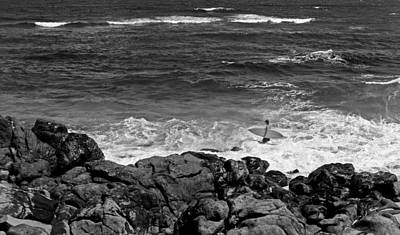 Photograph - Surfer Near The Rocks by John Orsbun