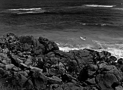Photograph - Surfer Near The Rocky Shore by John Orsbun