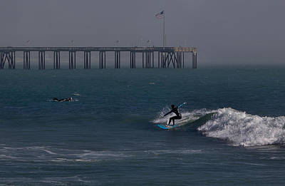 Photograph - Surfing Off The Pier by Michael Gordon