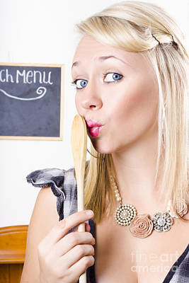 Surprised Female Kitchen Cook Hiding Secret Recipe Art Print by Jorgo Photography - Wall Art Gallery