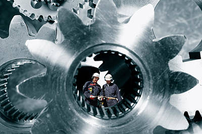 Photograph - Surreal Image Of Workers Inside Giant Gears And Cogs by Christian Lagereek