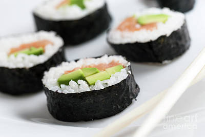 Tasty Photograph - Sushi Rolls With Salmon, Avocado, Rice In Seaweed And Chopsticks On A Plate. by Michal Bednarek