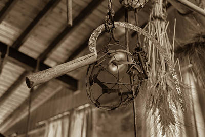 Cyprus Photograph - Suspended Sickle And Hops by Iordanis Pallikaras