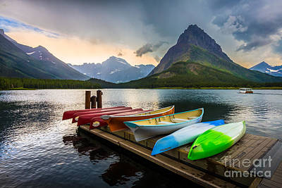 Reflective Surfaces Photograph - Swiftcurrent Canoes by Inge Johnsson