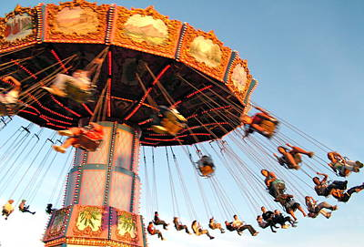 Photograph - Swinging At The Fair by Caroline Reyes-Loughrey