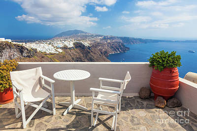 Photograph - Table And Chairs On Roof With A Panorama View On Santorini Island, Greece. by Michal Bednarek