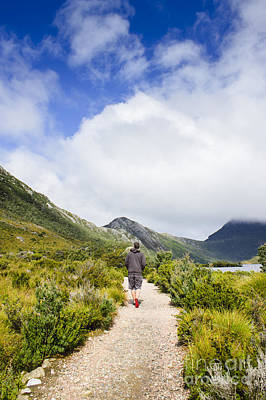Tasmanian Man Hiking Along A Scenic Mountain Trail Art Print by Jorgo Photography - Wall Art Gallery
