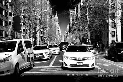 Photograph - Taxi's On 5th Avenue by John Rizzuto