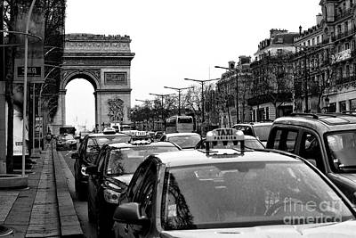 Of Artist Photograph - Taxis On Champs-elysees by John Rizzuto