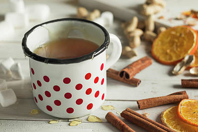 Tea In A Dotted Mug On White Background Art Print by Denes Demeter