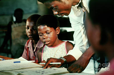Photograph - Teacher Teaching A Child by Wernher Krutein