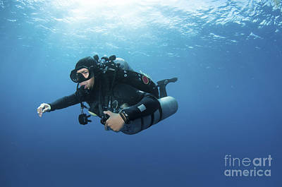 Technical Diver With Equipment Swimming Art Print by Karen Doody