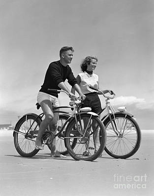 Photograph - Teen Boy And Girl Biking At The Beach by H. Armstrong Roberts/ClassicStock