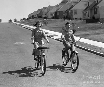 Photograph - Teen Boy And Girl Riding Bikes, C.1950s by H. Armstrong Roberts/ClassicStock