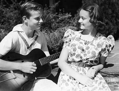 Photograph - Teen Boy Serenading Girl With Guitar by H. Armstrong Roberts/ClassicStock
