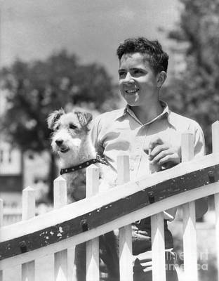 Pet Care Photograph - Teen Boy With Fox Terrier, C.1930s by H. Armstrong Roberts/ClassicStock