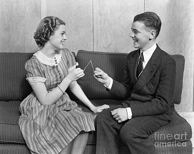 Photograph - Teen Couple Pulling Wishbone, C.1930s by H. Armstrong Roberts/ClassicStock