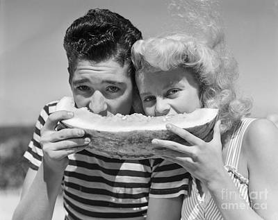 Photograph - Teen Couple Sharing Watermelon, C.1950s by H. Armstrong Roberts/ClassicStock