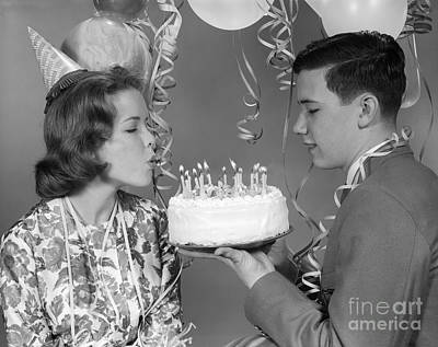 Teen Girl Blowing Out Birthday Candles Art Print