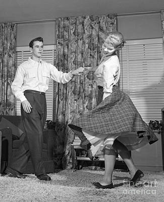 Photograph - Teenage Couple Dancing Jitterbug by Debrocke/ClassicStock
