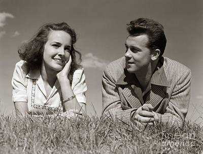Photograph - Teenage Couple Lying In Grass, C.1940s by H. Armstrong Roberts/ClassicStock
