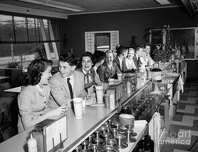 Teens At Soda Fountain Counter, C.1950s Art Print by H. Armstrong Roberts/ClassicStock