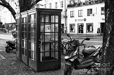 Telephone Booths In Salzburg Art Print by John Rizzuto