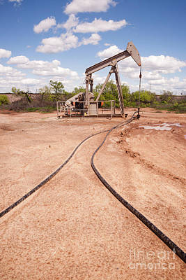 Photograph - Texas Oil Pump Jack Fracking Crude Extraction Machine by Christopher Boswell