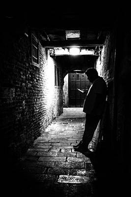 35mm Photograph - Texting - Venice, Italy - Black And White Street Photography by Giuseppe Milo