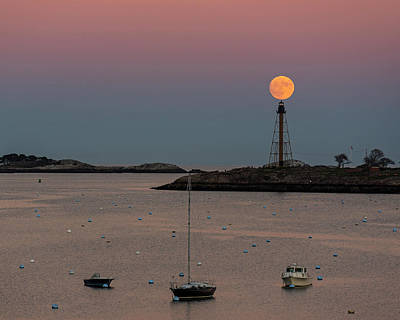 Photograph - The 2016 Supermoon Balancing On The Marblehead Light Tower In Marblehead Ma by Toby McGuire