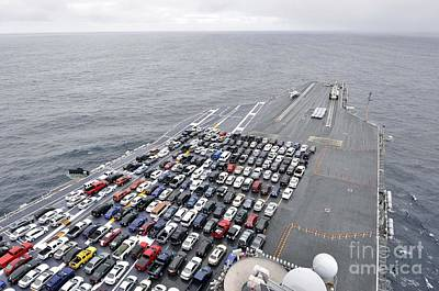 The Aircraft Carrier Uss Ronald Reagan Transports Sailors Vehicles. Print by Celestial Images