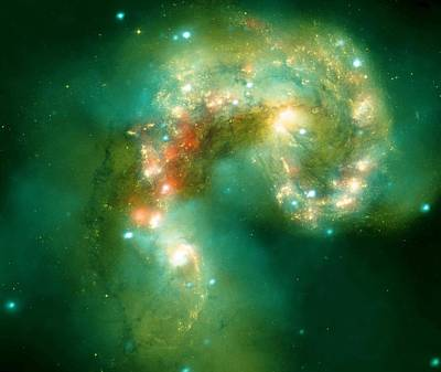 Intergalactic Space Photograph - The Antennae Galaxies by American School