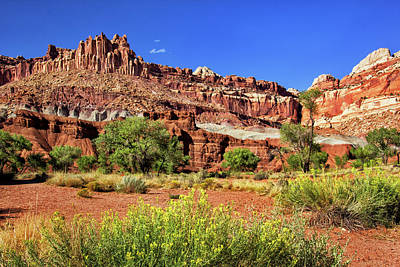 Photograph - The Castle Rock Formation In Capitol Reef by Carolyn Derstine