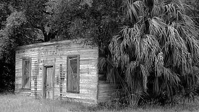 Photograph - The corner store by Ronald Broome