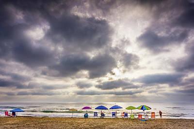 Photograph - The Diehard Beach Lovers by Gary Gillette