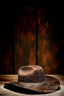 Cowboy Hat Photograph - The Dirty Brown Hat by Olivier Le Queinec