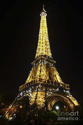 The Eiffel Tower At Night Illuminated, Paris, France. Art Print by Perry Van Munster