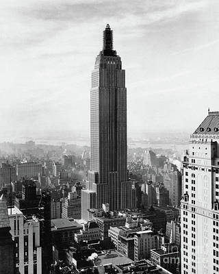 New York City Skyline Photograph - The Empire State Building Under Construction by Jon Neidert