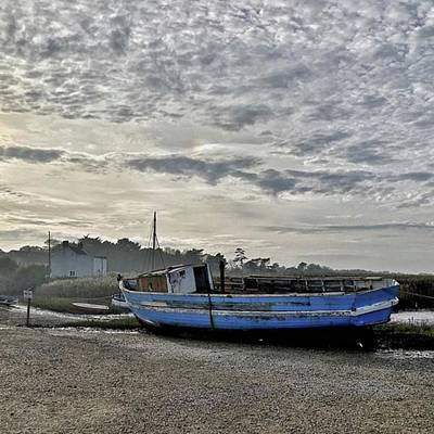 Norfolk Photograph - The Fixer-upper, Brancaster Staithe by John Edwards