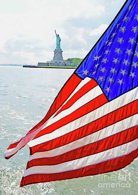 Photograph - The Flag Flies For The Statue Of Liberty by Tom Wurl
