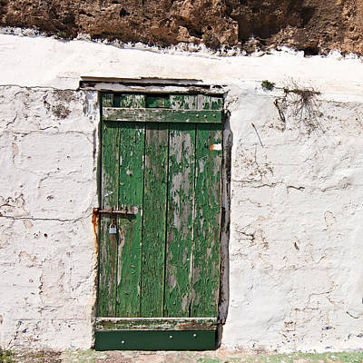 Photograph - The Green Old Door With Peeling Paint In A White Wall by Pedro Cardona