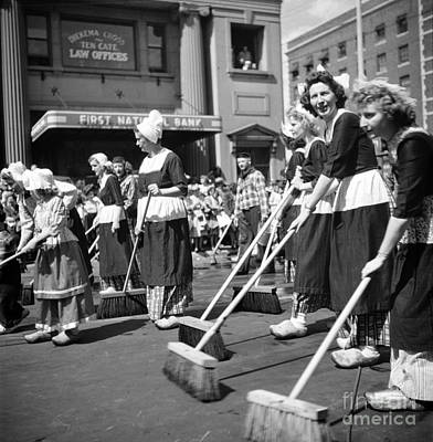 Holland Michigan Photograph - The Holland Michigan Tulip Parade, 1953. by The Harrington Collection