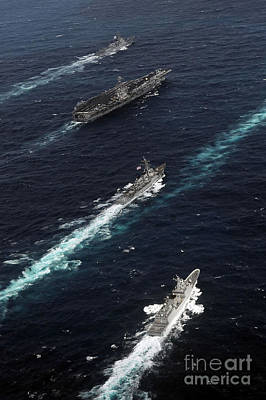 Foreign Military Photograph - The John C. Stennis Carrier Strike by Stocktrek Images